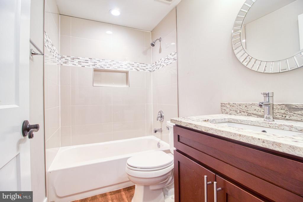 lower level rec room bathroom - 7627 LISLE AVE, FALLS CHURCH