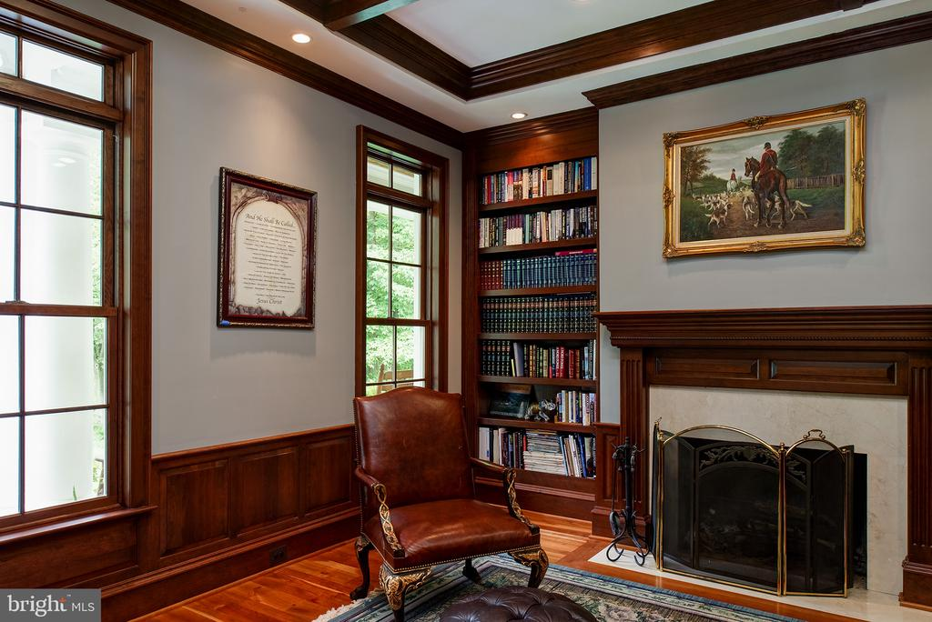 It is very peaceful to read beside the fire. - 41430 FOX CREEK LN, LEESBURG