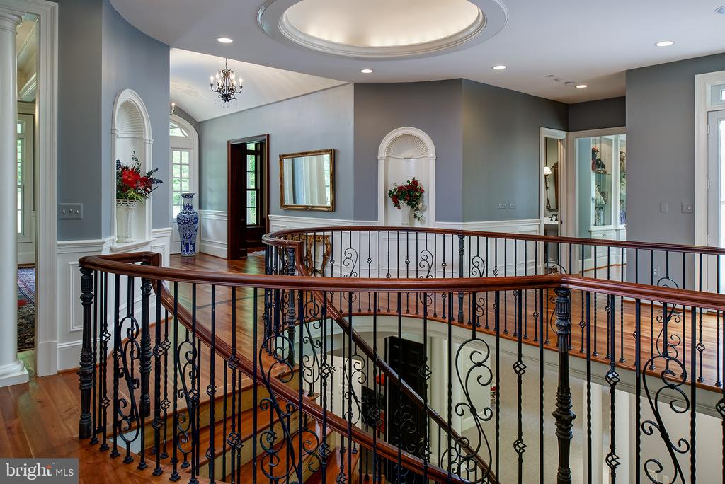 The custom spiral staircase descends to the LL - 41430 FOX CREEK LN, LEESBURG