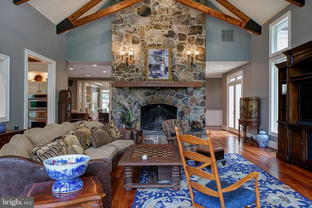 The grand fireplace is wood burning & gas ready - 41430 FOX CREEK LN, LEESBURG