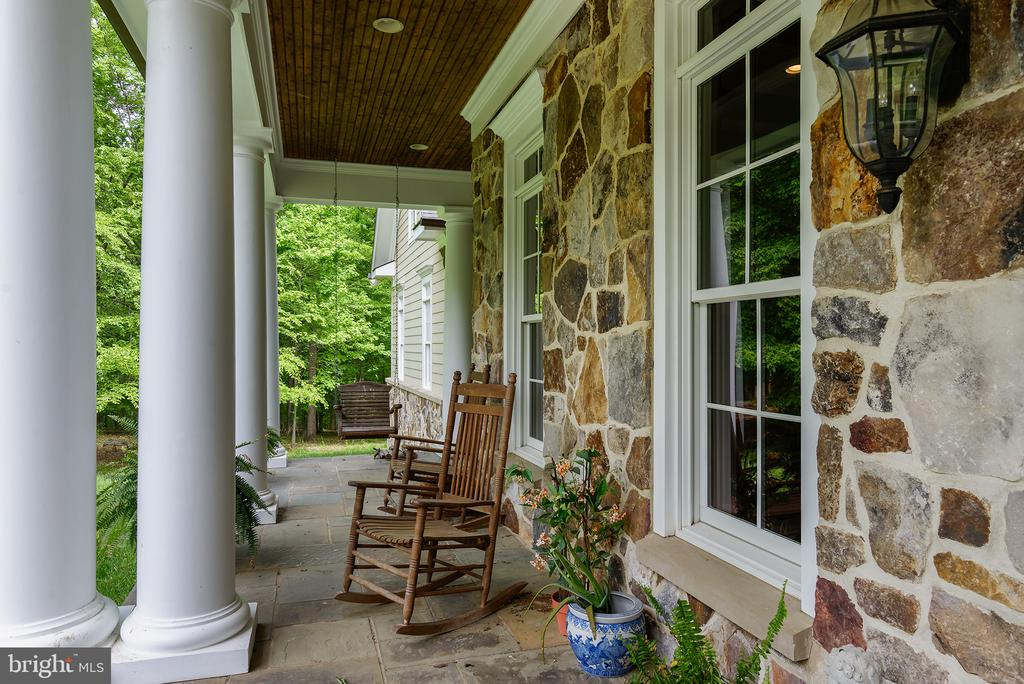 Beautiful stone work surrounds you on the porch - 41430 FOX CREEK LN, LEESBURG