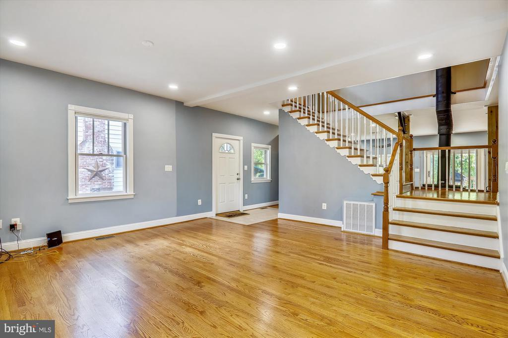 Family room/dining room/Stairs to Upper level - 4707 FORDHAM RD, COLLEGE PARK
