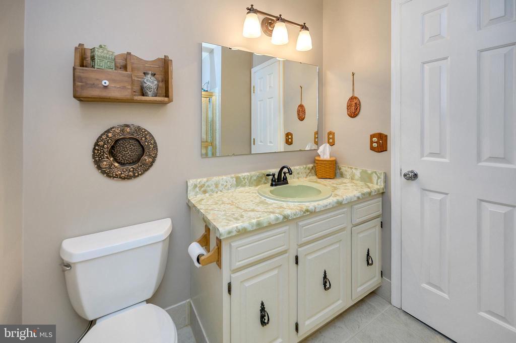 New flooring and toilet in hall upper full bath - 508 GLENEAGLE DR, FREDERICKSBURG