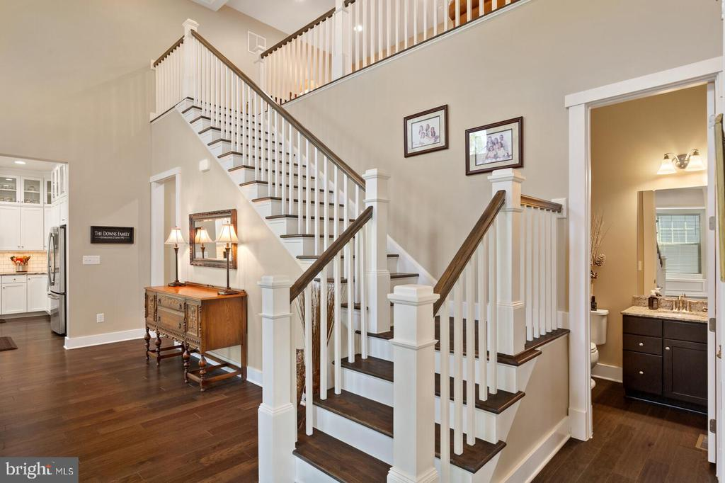 The grand staircase leads to the loft - 17076 SILVER ARROW DR, DUMFRIES
