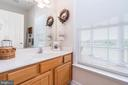 1/2 bath on the main level by the laundry room - 160 WILLOWDALE LN, FREDERICKSBURG