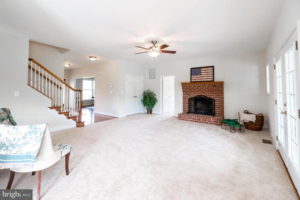 Wood burning fireplace in the family room - 160 WILLOWDALE LN, FREDERICKSBURG