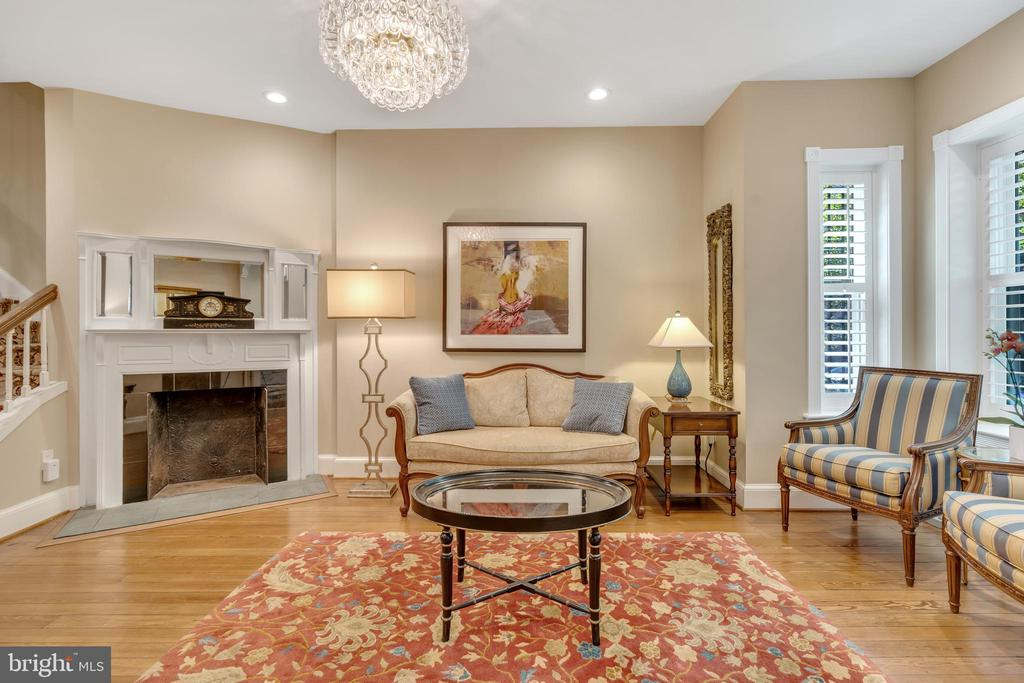 Spacious living room with new chandelier - 1727 WILLARD ST NW, WASHINGTON