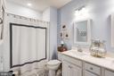 Full bath with stunning Travertine marble flooring - 23631 HAVELOCK WALK TER #420, ASHBURN