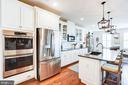 Chef's kitchen includes double wall oven - 23631 HAVELOCK WALK TER #420, ASHBURN