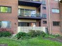 Rear view. Condo is renovating the patio. - 7358 LEE HWY #T1, FALLS CHURCH