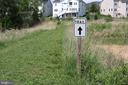 Nature trail in the HOA common area - 1109 GARDEN STONE CT, CLARKSBURG