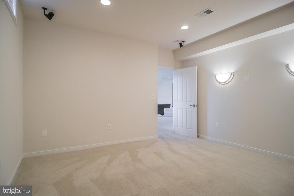 Lower level media room with sconce lighting - 15 SMELTERS TRACE RD, STAFFORD