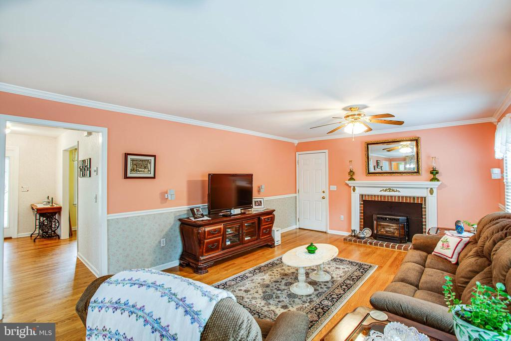 family room with pellet stove - 413 COLLINGWOOD DR, FREDERICKSBURG