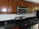 Kitchen with granite counters and dishwasher - 2504 22ND ST NE #6, WASHINGTON