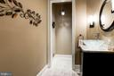 Main level powder room w/high end floor/lighting. - 11594 CEDAR CHASE RD, HERNDON