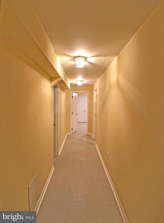 Basement hall way - 6905 RANNOCH RD, BETHESDA