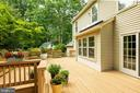 Rear deck overlooking mature landscaping - 1232 BISHOPSGATE WAY, RESTON