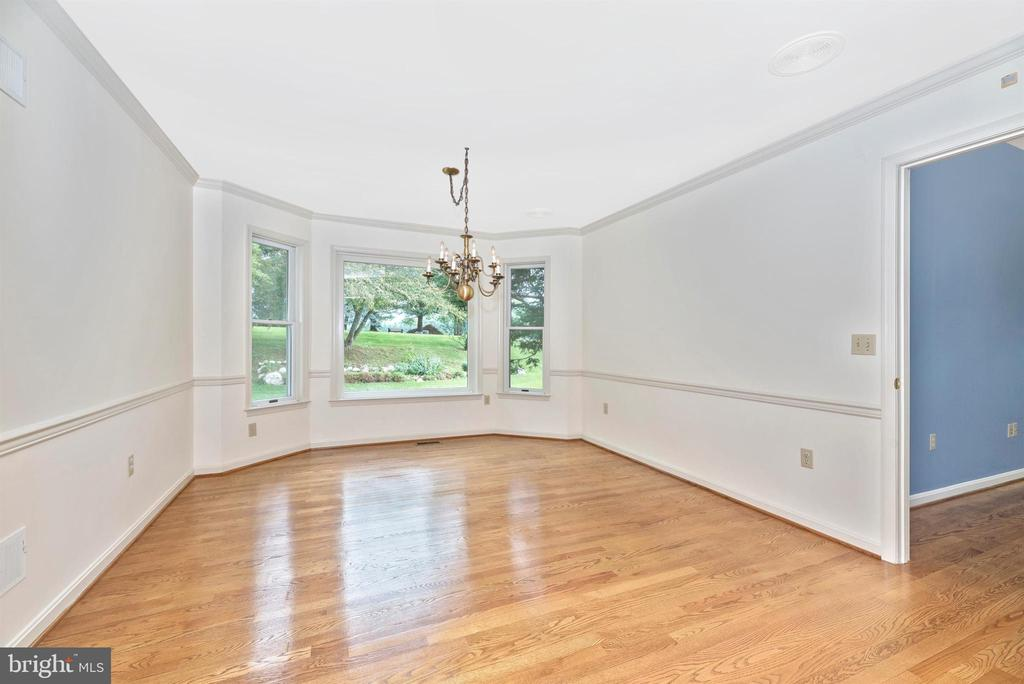 Dining room has expansive bay window. - 7799 COBLENTZ RD, MIDDLETOWN
