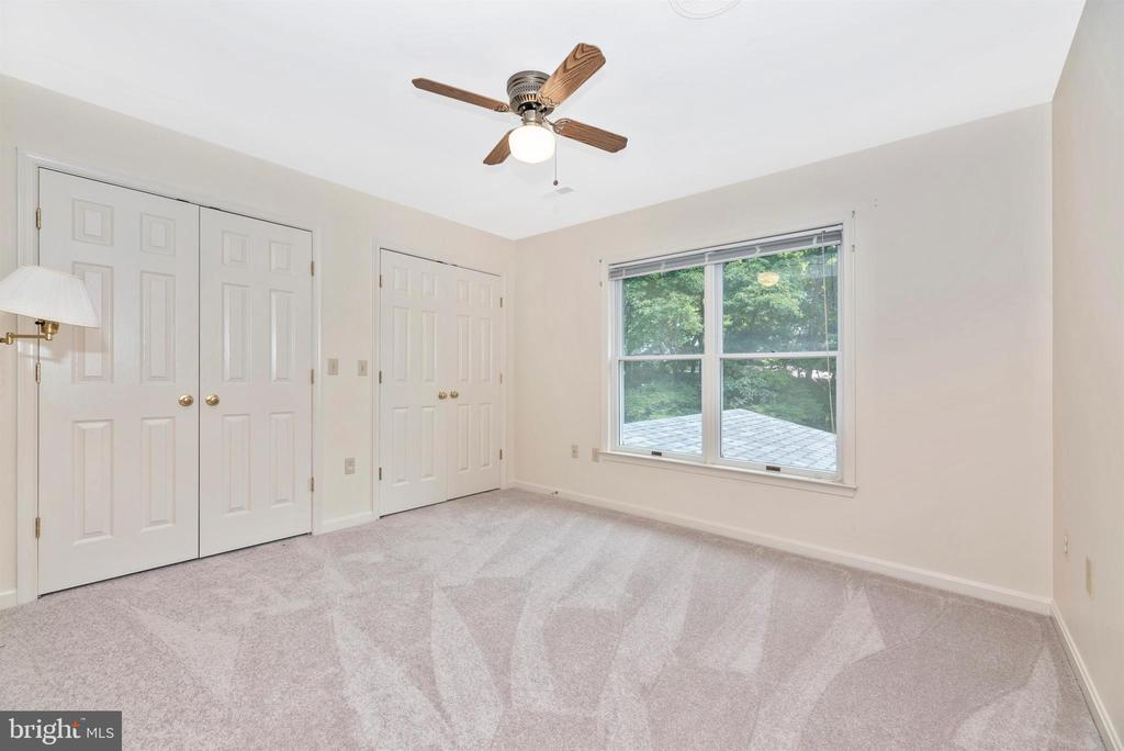 Bedroom 2 with ceiling fan. - 7799 COBLENTZ RD, MIDDLETOWN
