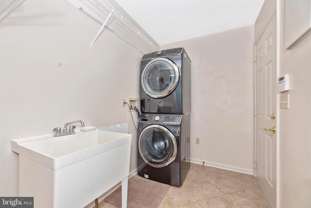 Laundry with utility tub off garage. - 7799 COBLENTZ RD, MIDDLETOWN