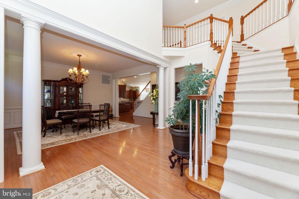 2 Story Foyer and 1st set of stairs - 7901 S RUN VW, SPRINGFIELD