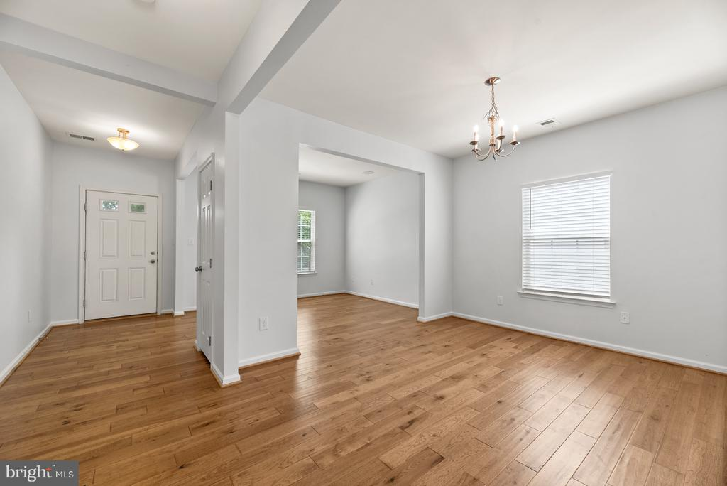 Entryway, Living Room, and Dining Room - 41 TOWN CENTER DR, LOVETTSVILLE