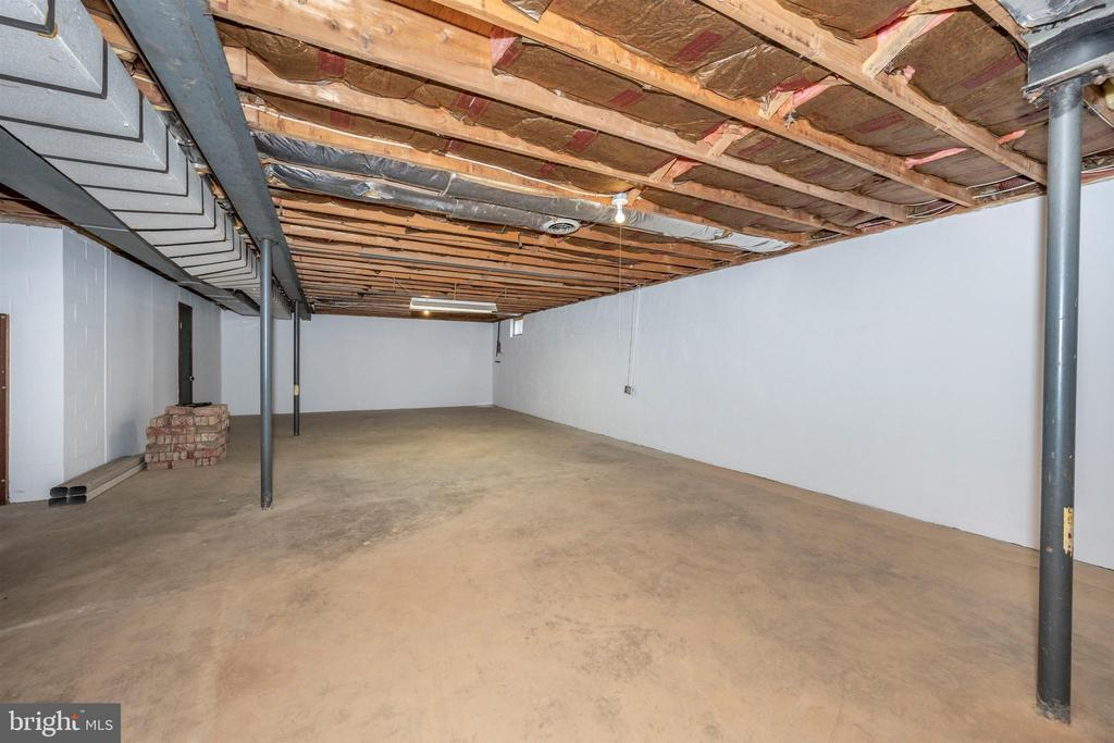 LARGE BASEMENT PAINTED WALLS W/ FIREPLACE ROUGH-IN - 6914 SUMMERSWOOD DR, FREDERICK