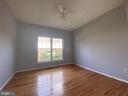 Bedroom 6 with NEW hardwood floor on Main Level - 6311 WILLOWFIELD WAY, SPRINGFIELD
