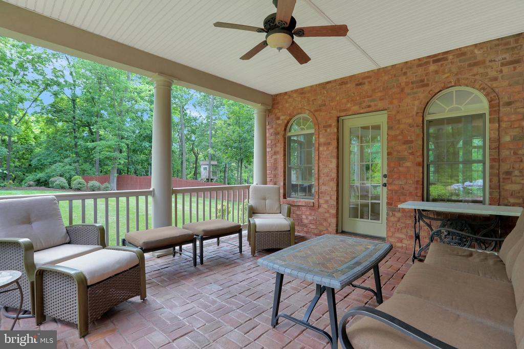 Covered porch off of sunroom - 92 EARLE RD, CHARLES TOWN