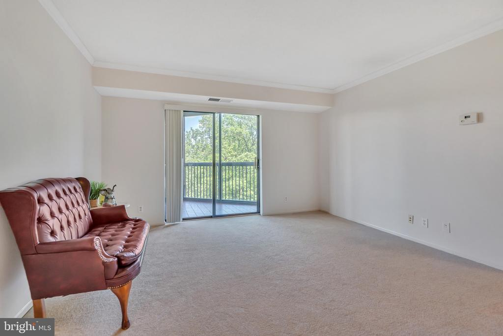 Living room with balcony access! - 5903 MOUNT EAGLE DR #610, ALEXANDRIA