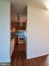 KITCHEN VIEW FROM BONUS ROOM - 301 S REYNOLDS ST #601, ALEXANDRIA