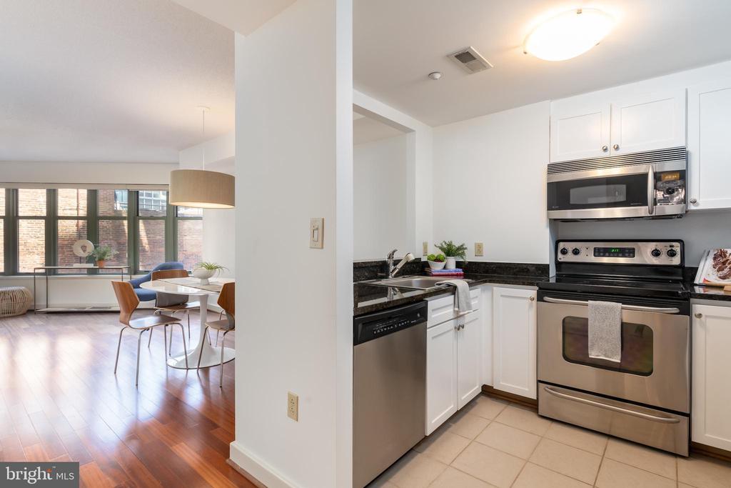 Kitchen enjoys natural light - 1150 K ST NW #411, WASHINGTON