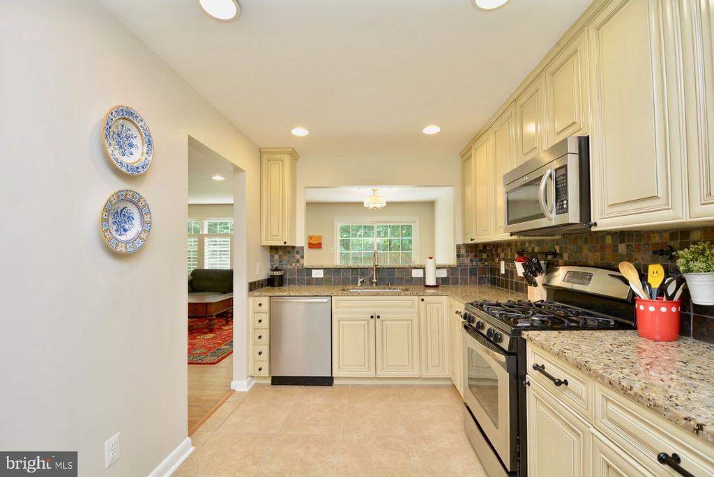 Large kitchen with granite counters. - 7701 HEMING PL, SPRINGFIELD