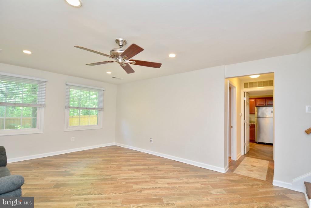 Lower level rec room with hardwood floors - 7701 HEMING PL, SPRINGFIELD