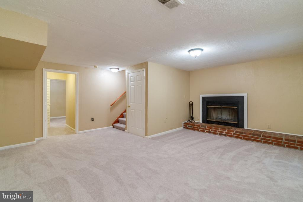Family Room has Wood-Burning Fireplace - 15415 BEACHWATER CT, DUMFRIES