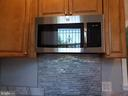 Over the stove GE Microwave - 1601 WOODHILL CT, LANDOVER