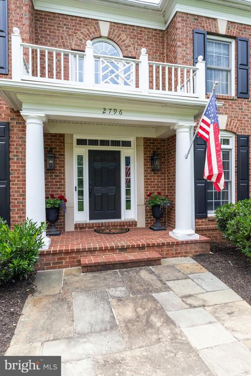 Stately main entrance with brick stoop. - 2796 MARSHALL LAKE DR, OAKTON