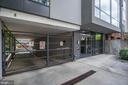 Garage entrance, 1 parking space included. - 1454 BELMONT ST NW #15, WASHINGTON