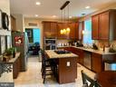 Gas cooking range in center island - 3545 GROUSE POINTE DR, STAFFORD