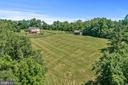 Fenced paddock with outdoor arena potential - 20634 ST LOUIS RD, PURCELLVILLE