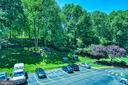 View of lush landscaping - 203 YOAKUM PKWY #317, ALEXANDRIA