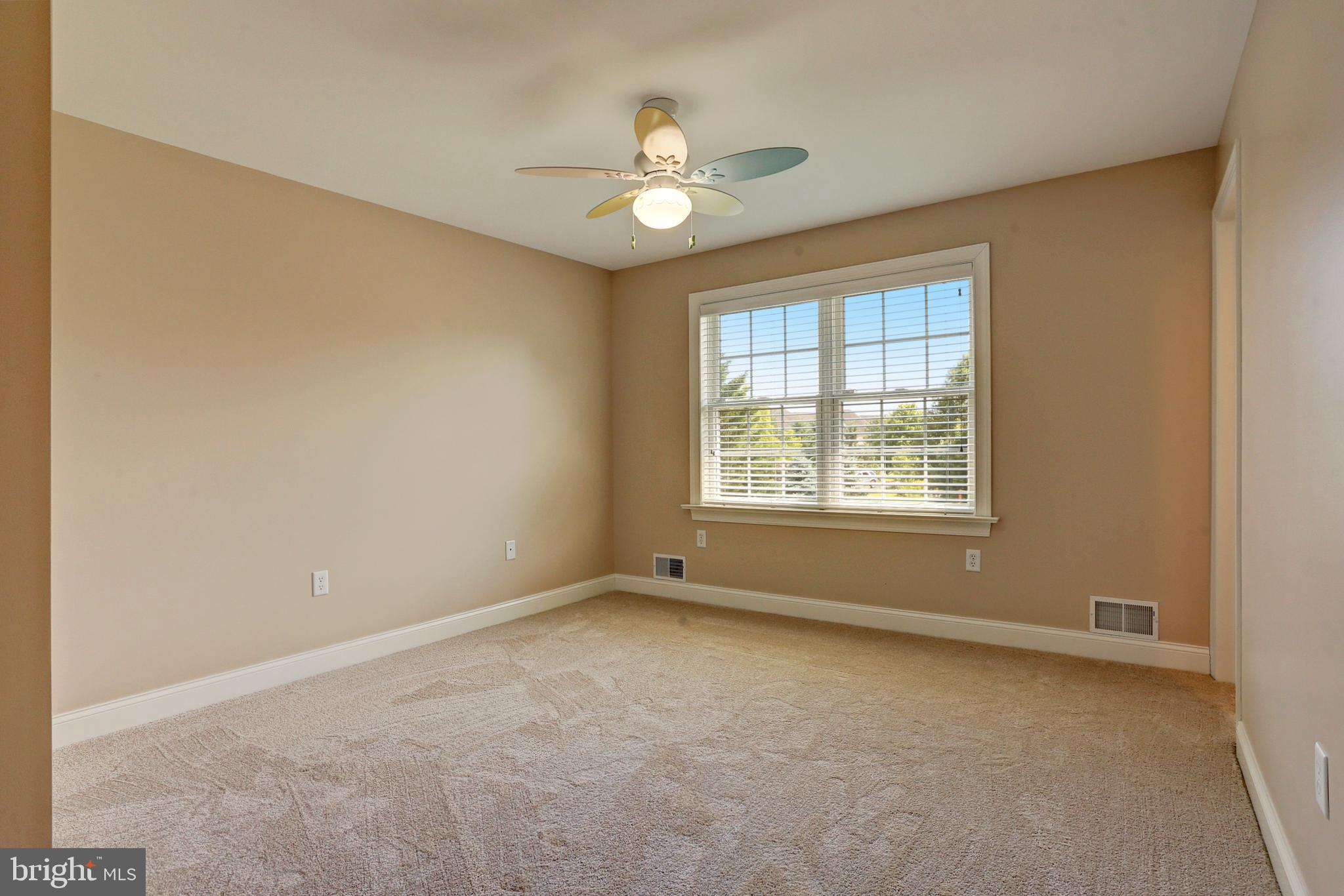 Bedroom 3 with Carpet and a Ceiling Fan