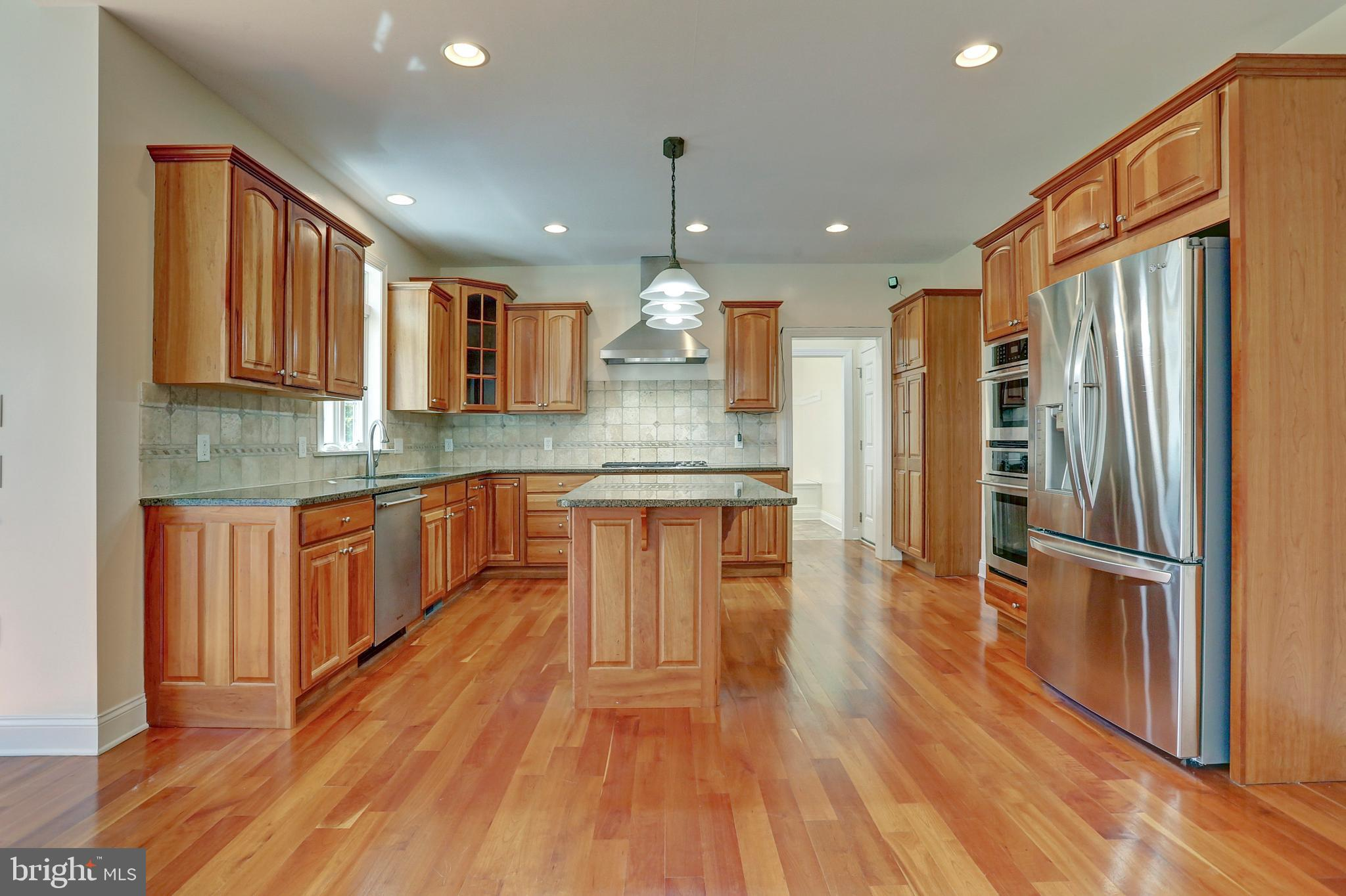 Cherry Wood Cabinets in the Beautiful Kitchen