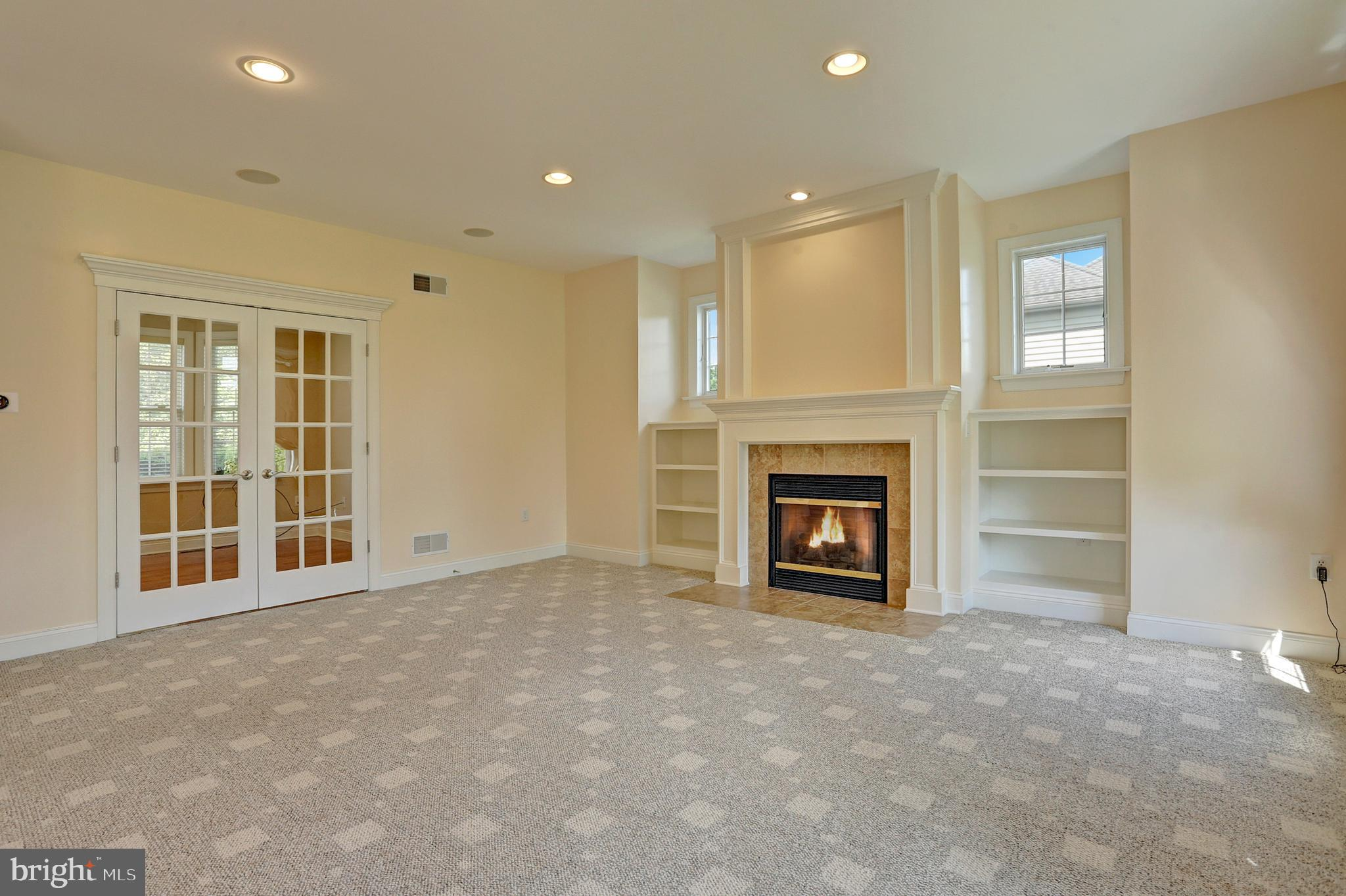 Family Room with a Gas Fireplace & Surround Sound