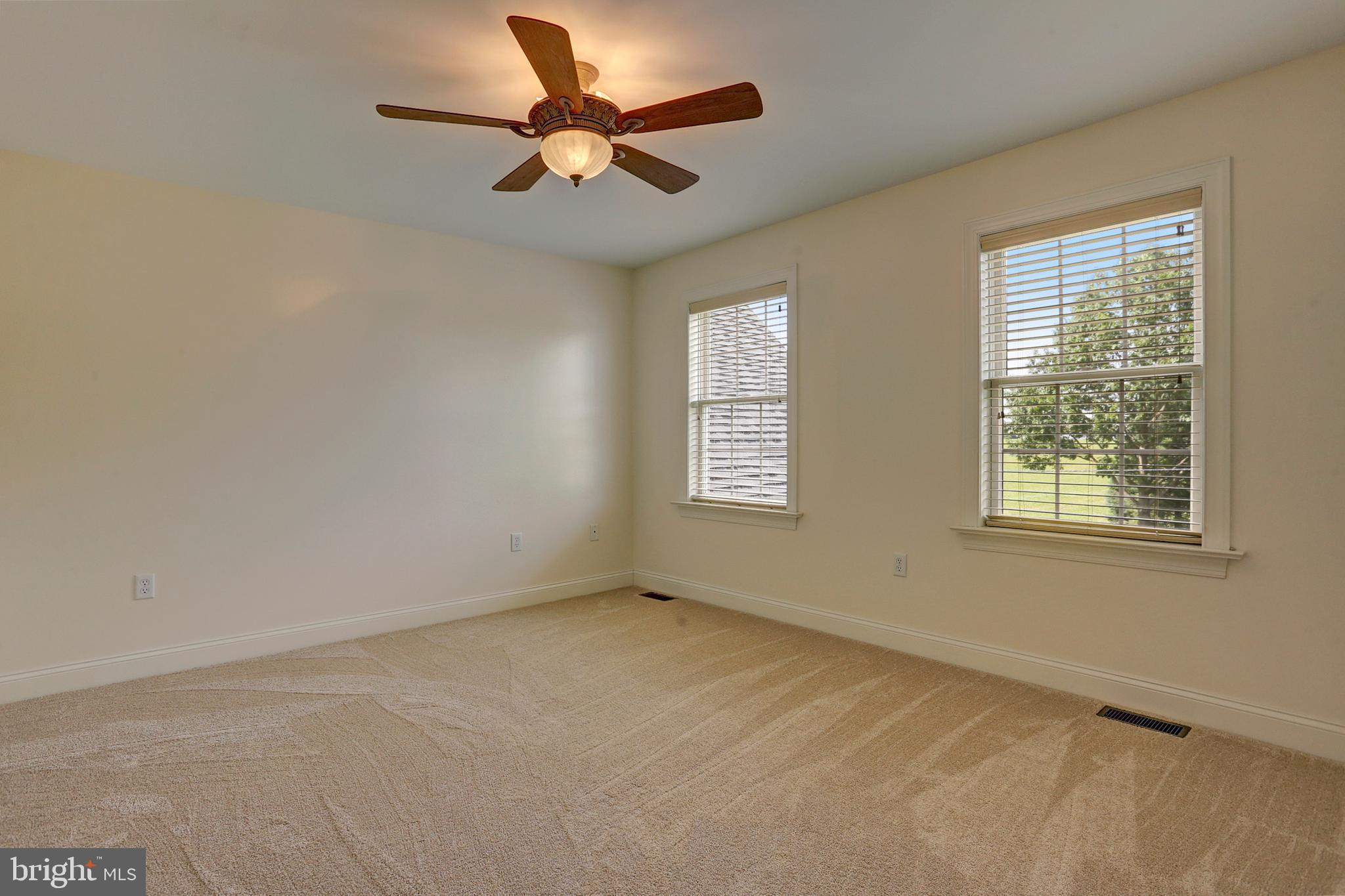 Bedroom 4 with Carpett and a Ceiling Fan