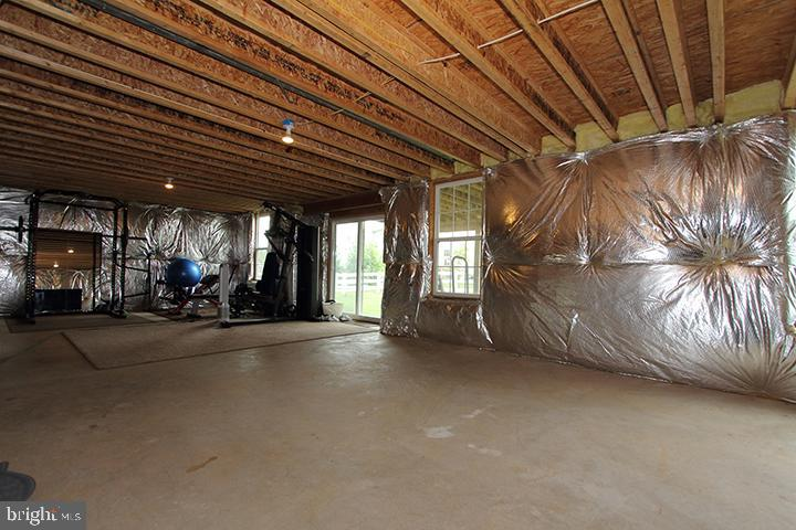 Unfinished basement with rough in for a full bath - 17352 TEDLER CIR, ROUND HILL