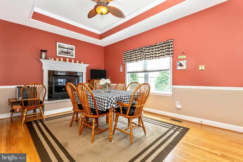 Breakfast area features a gas fireplace. - 2689 MONOCACY FORD RD, FREDERICK