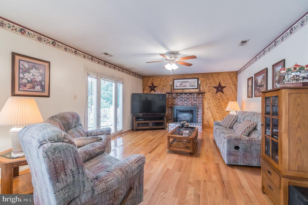 Brick hearth fireplace in family room - 22 BALLANTRAE CT, STAFFORD