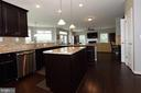 Kitchen with SS appliances & upgraded cabinets - 20999 HONEYCREEPER PL, LEESBURG