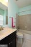 Princess suite's full bathroom - 20999 HONEYCREEPER PL, LEESBURG